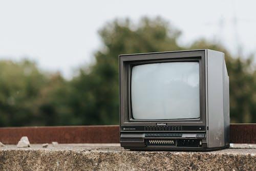 Retro TV set on concrete surface