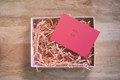 Greeting card representing With Love inscription on cardboard shavings