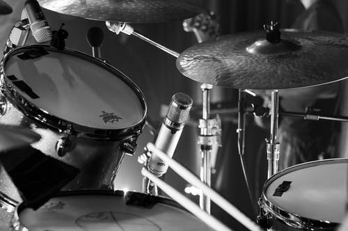 Black and white of modern drums with microphone on stage during music concert