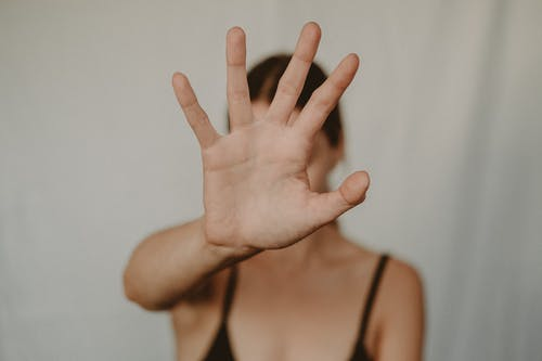 Woman showing stop gesture with hand