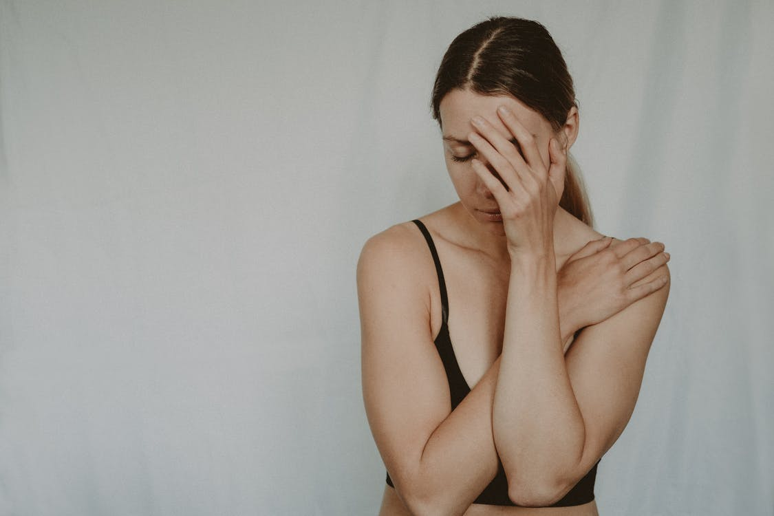 Young sad woman with closed eyes