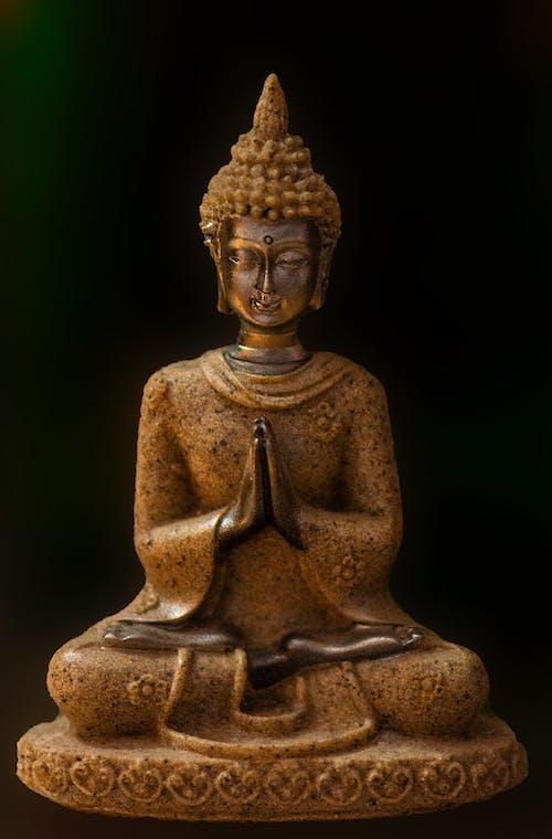 Gold Buddha Figurine on Black Surface