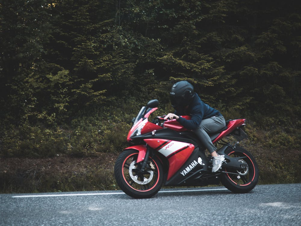 Person Riding on Sports Bike