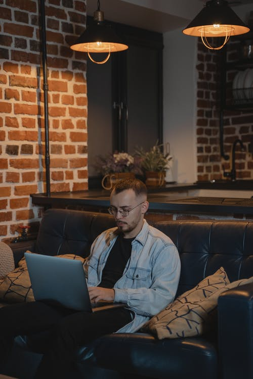 Man in Blue Dress Shirt Using Laptop Computer