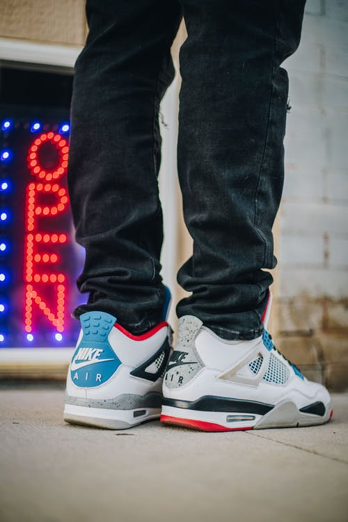 Person in Blue and White Nike Air Max 90