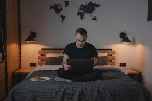 Man in Gray Crew Neck T-shirt Using Macbook