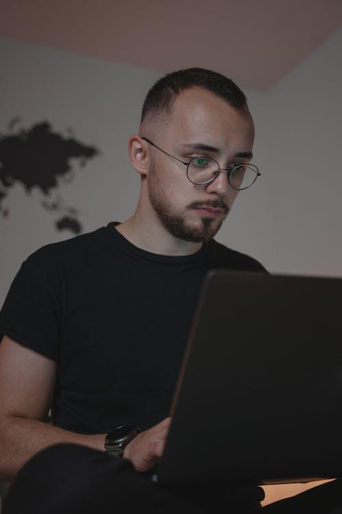 Man in Black Crew Neck T-shirt Wearing Eyeglasses