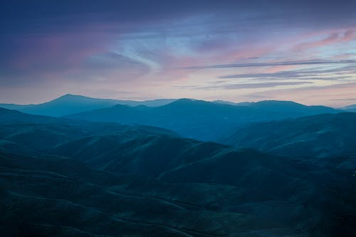 Peaceful range of remote mountains in twilight