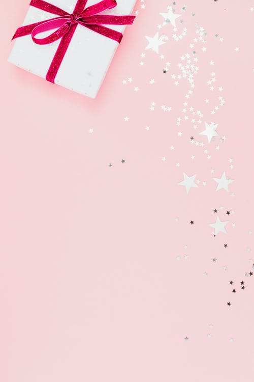 Close-Up Shot of a Gift Wrapped with Pink Ribbon