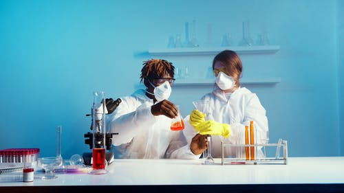 A Man and a Woman Doing an Experiment