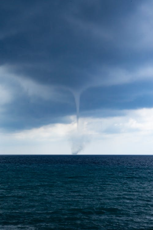 Waterspout Forming Over The Horizon