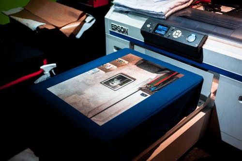 Blue and White Printer on Brown Wooden Desk