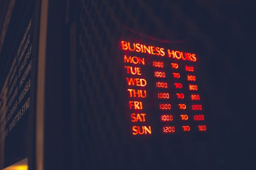 Bright board with business hours of cafe