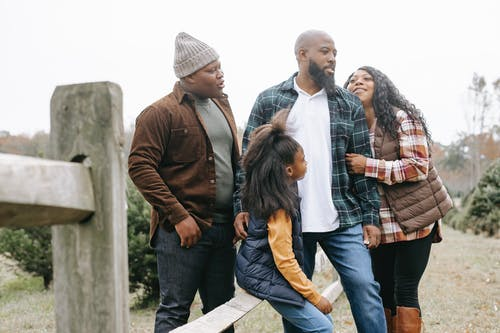 African American family near fence on farm