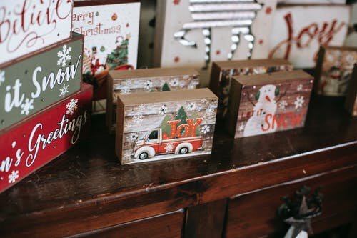 Collection of bright boxes with New Year ornament on wooden table during festive event