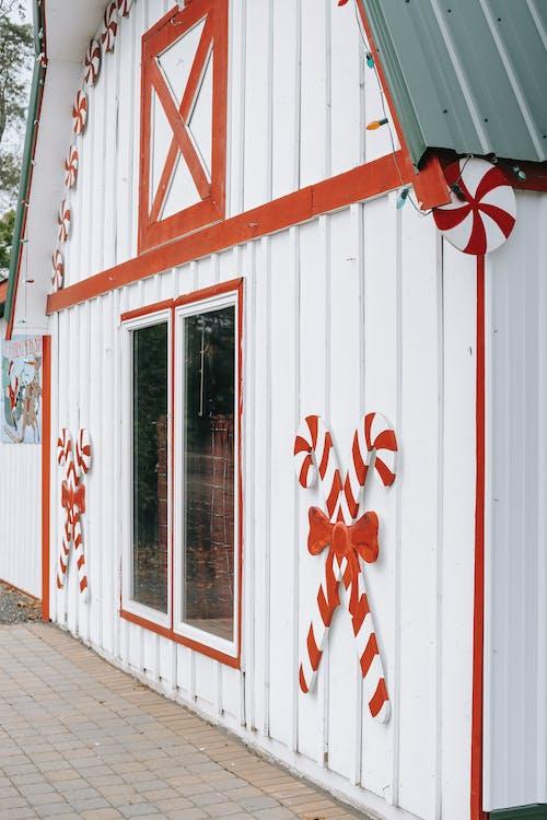 Modern house facade with Christmas decor on wall