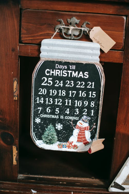 Decorative advent calendar with Christmas illustration in house