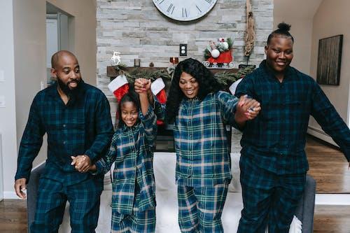 Happy black family having Christmas celebration together