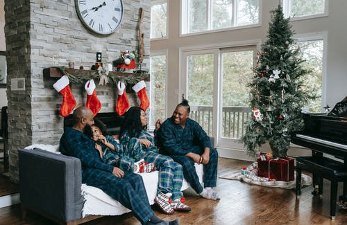 Happy black family enjoying Christmas holidays at home
