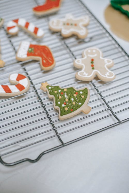 Collection of tasty gingerbread cookies with Christmas ornament