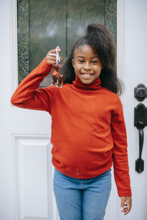 Happy cute black girl with handmade Christmas decoration