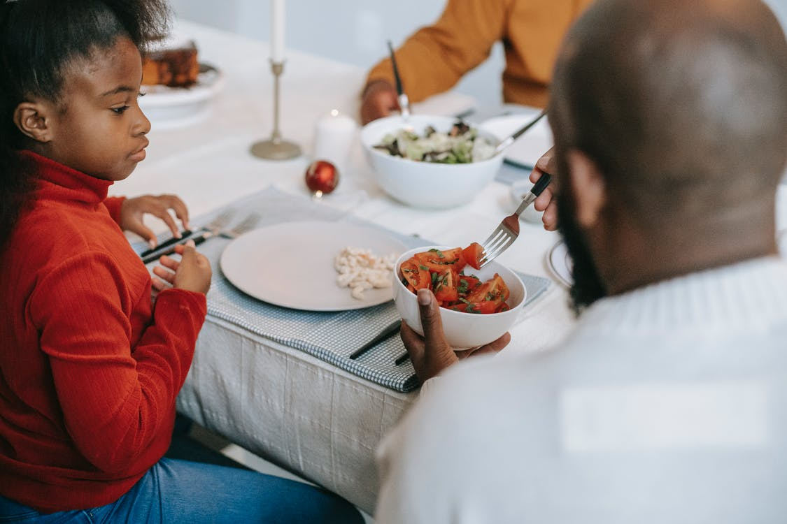 Black family having tasty dinner