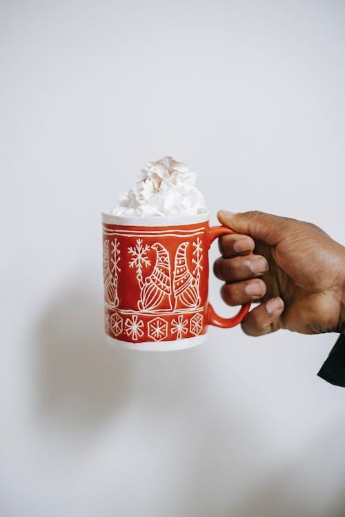 White and Red Ceramic Mug With White Powder