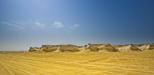 Sandstone hills in vast hot desert