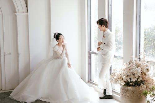 Cheerful ethnic newlywed couple enjoying wedding day
