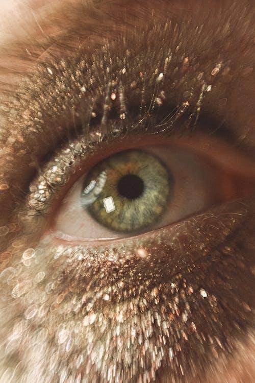 Eye in shiny silver glitters