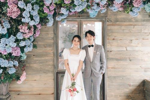 Man in Gray Suit Jacket Beside Woman in White Wedding Dress