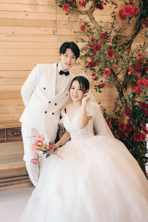 Man in White Suit and Woman in White Wedding Dress