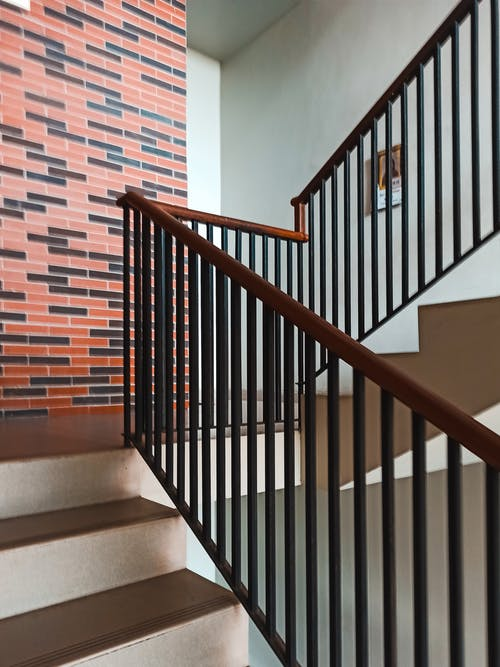 Staircase with railing in modern apartment building