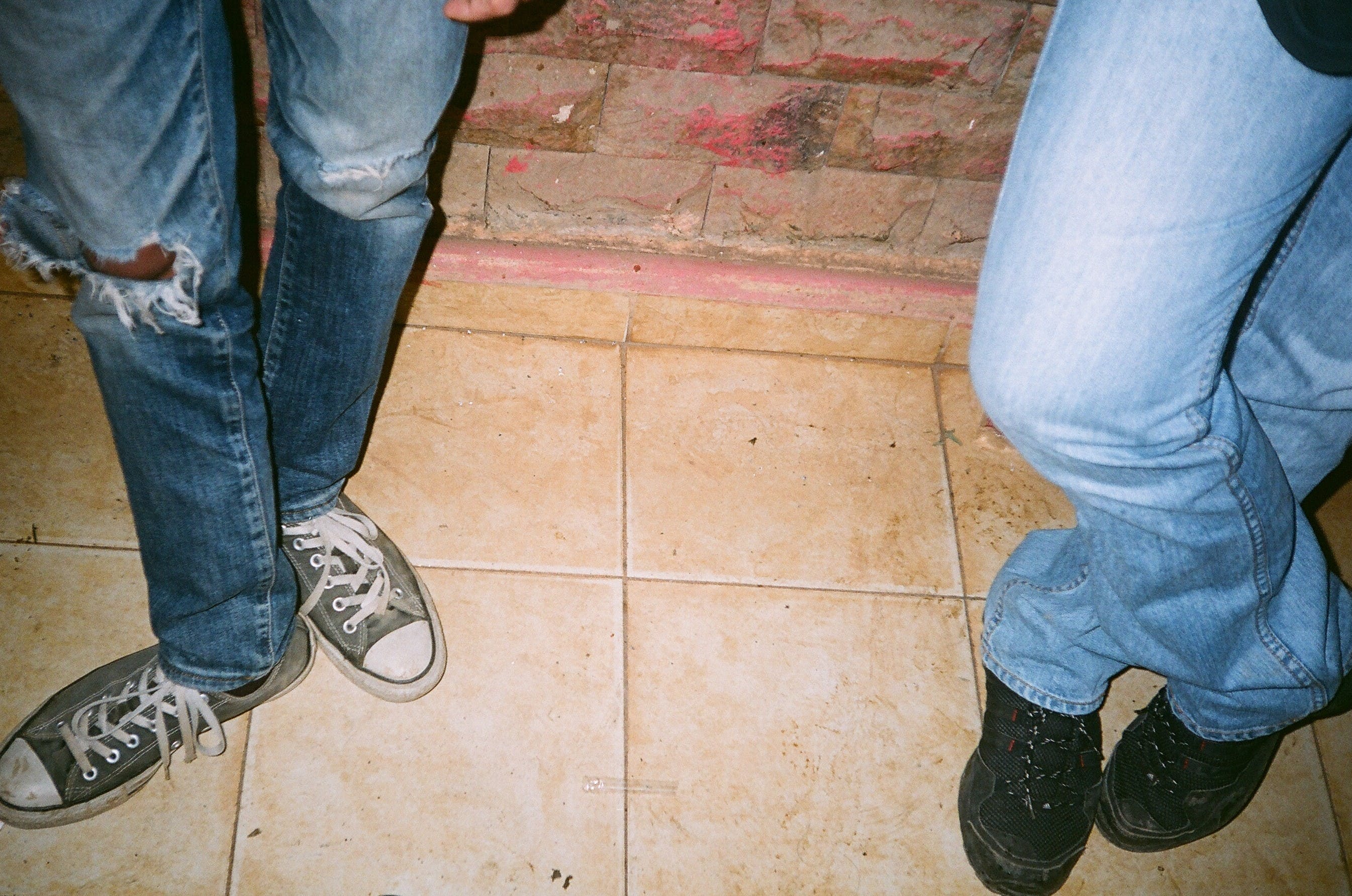 Two Person Wearing Blue Jeans and Lace-up Shoes