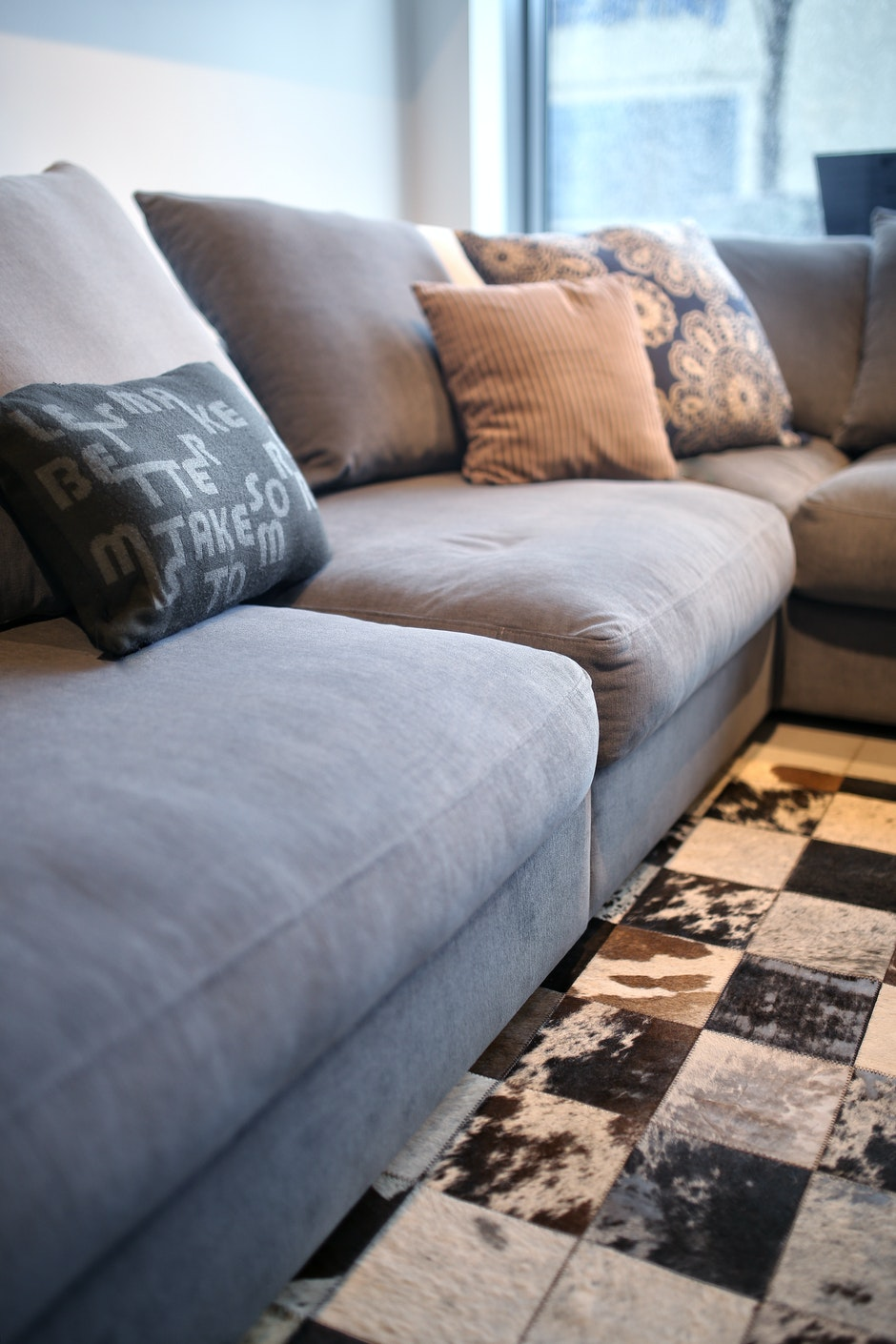 Comfortable grey couch with pillows