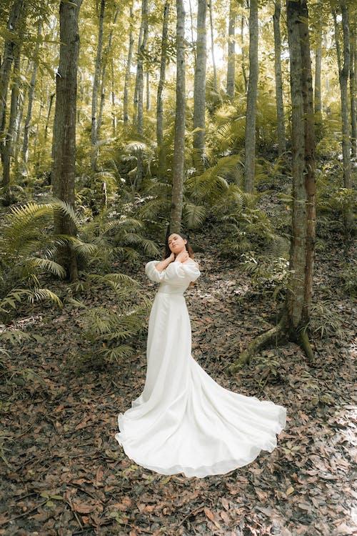 Elegant bride in forest on wedding day
