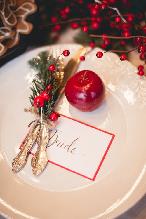 Red and Gold Baubles on White Ceramic Plate