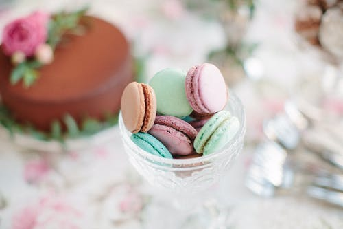 Pink and Green Macaroons on Clear Glass Bowl