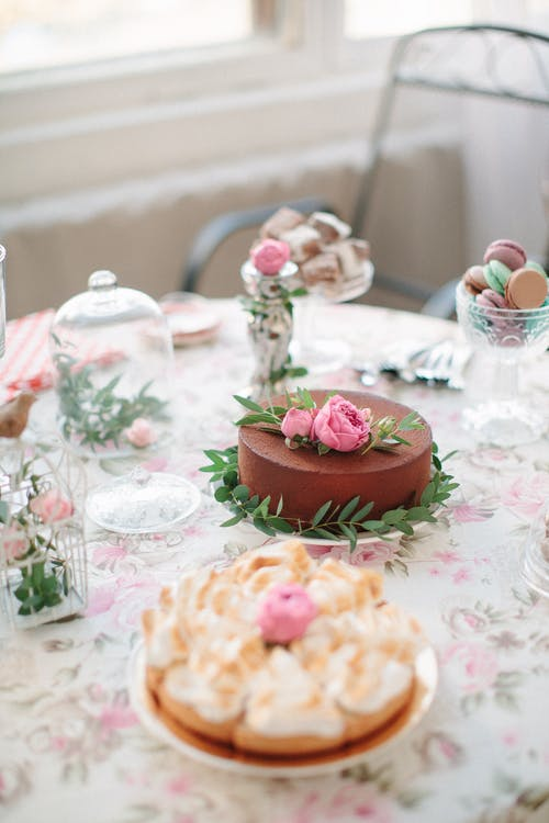 Pink and White Floral Cake on Table