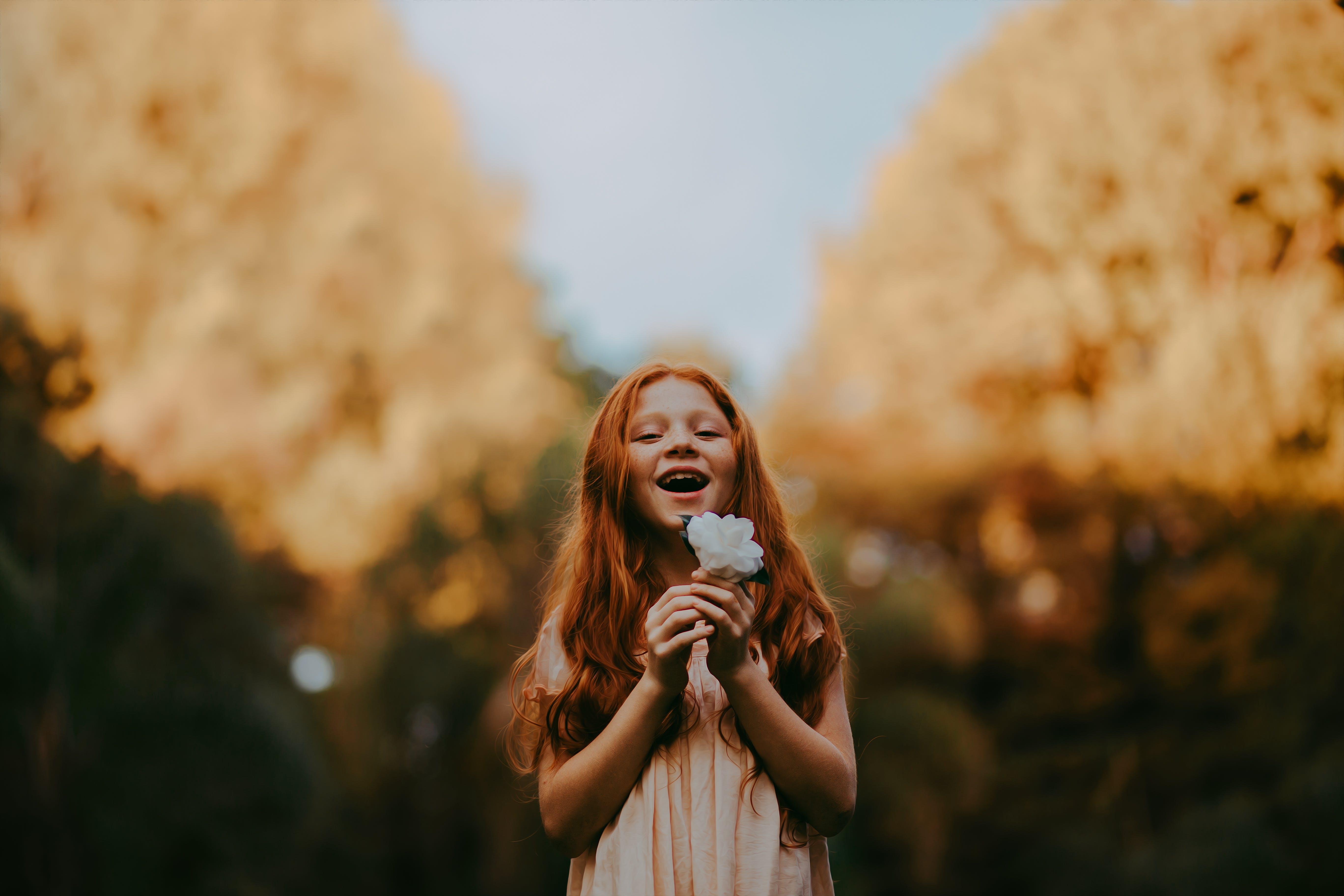 Girl Holding White Flower