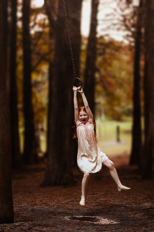 Girl Hanging on Swing