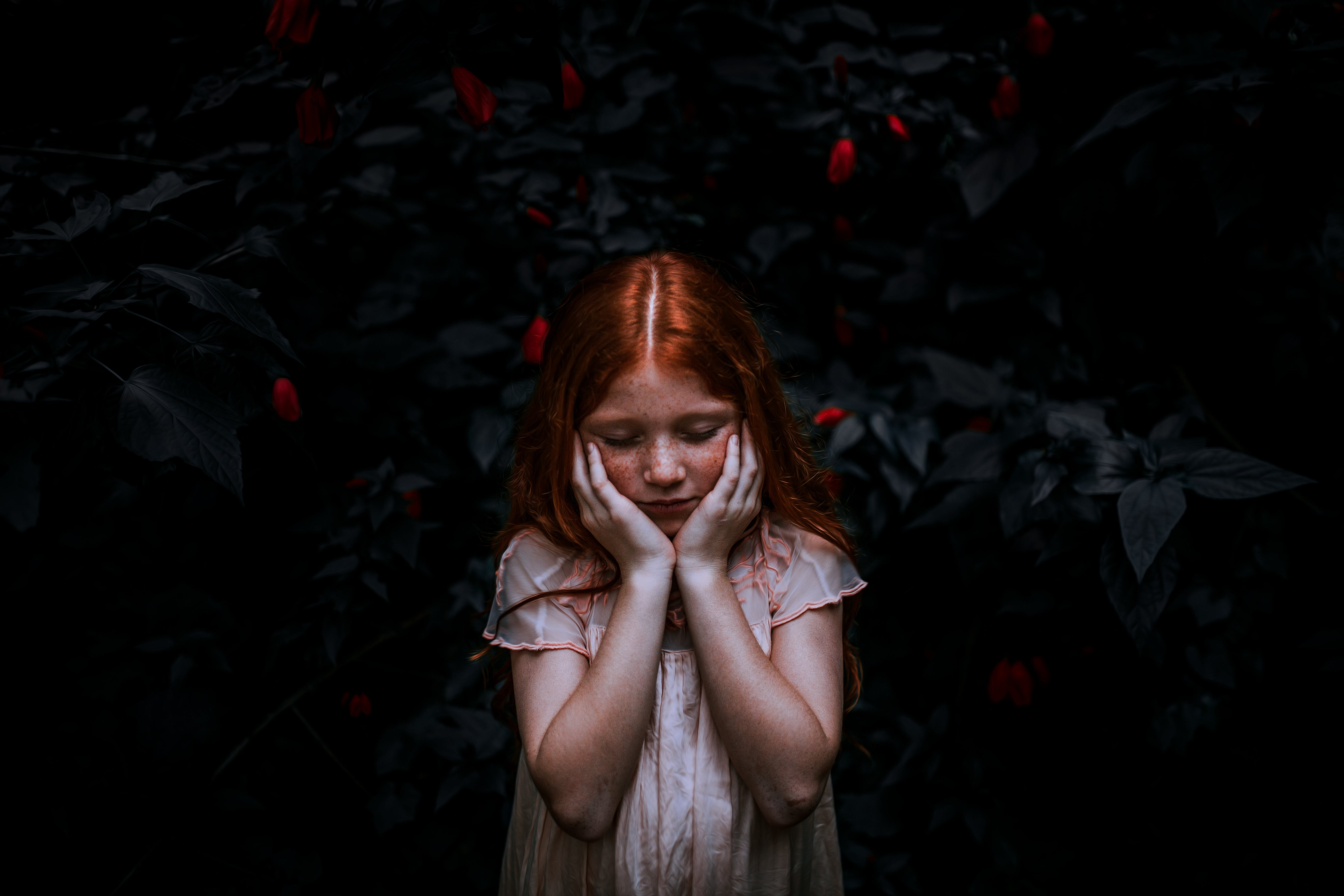 Red-haired Girl Standing Near Plant
