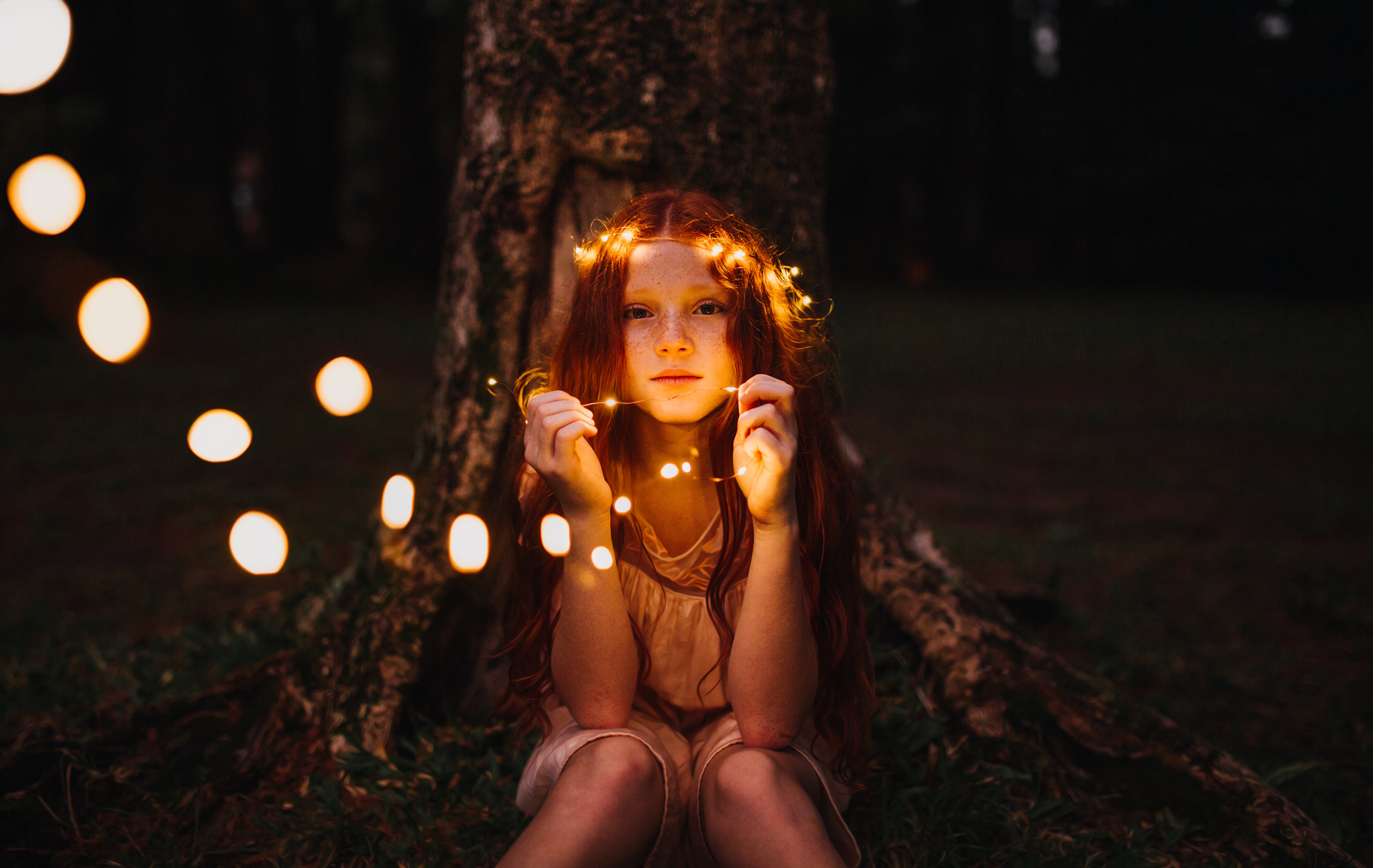 Girl Holding String Lights