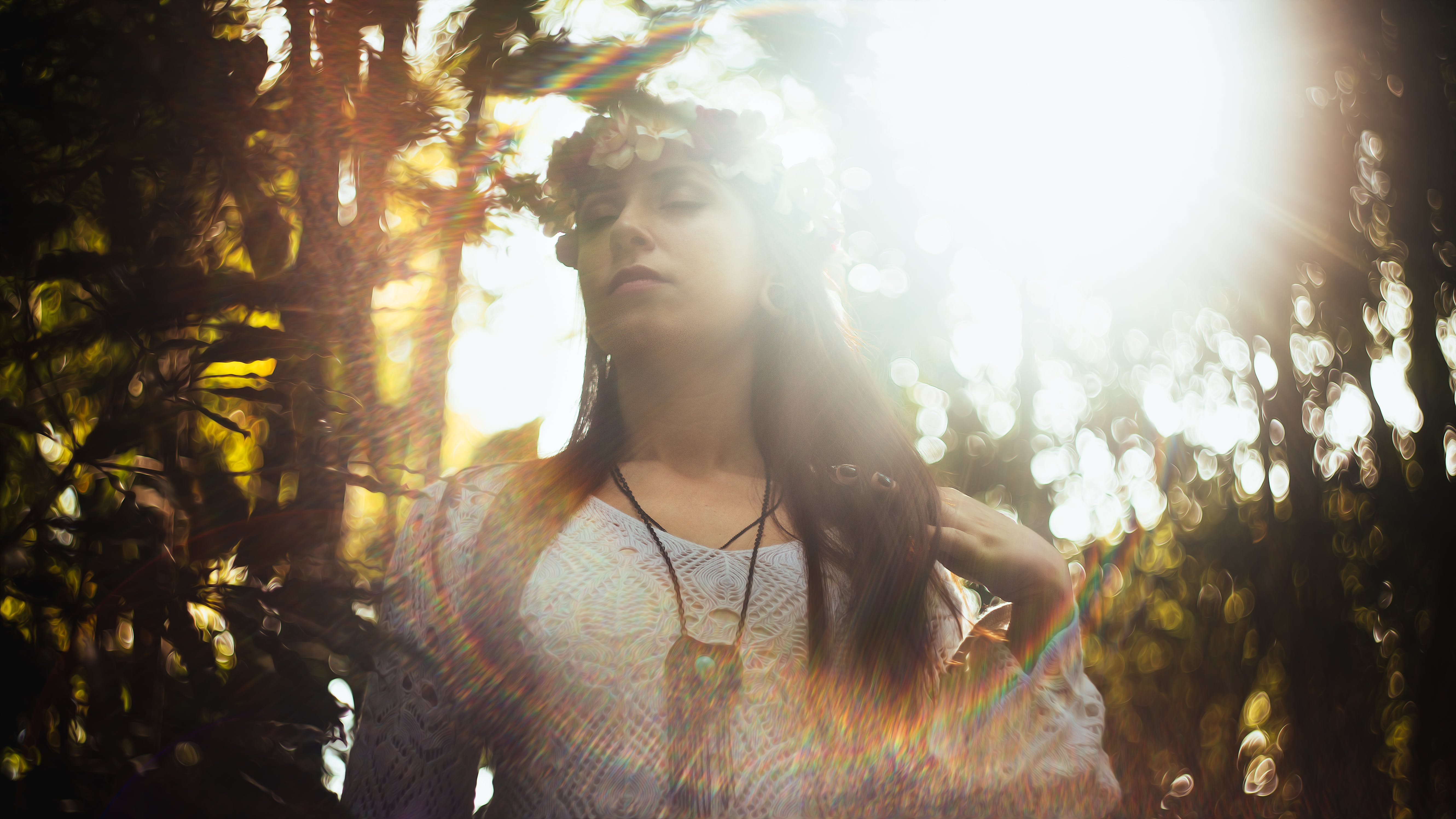 Woman Closing Her Eyes Under Sun Rays