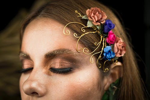 Woman With Flowers on Her Ear