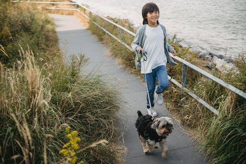 Happy little boy running with puppy