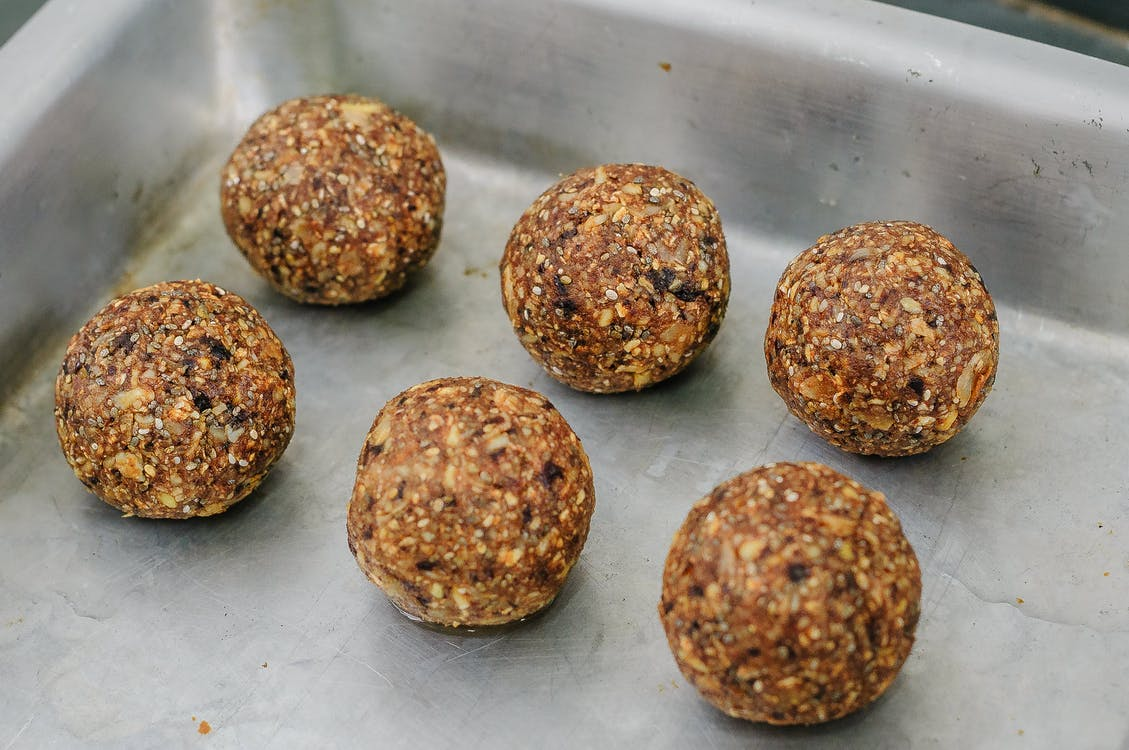 Rows of delicious energy balls in baking pan