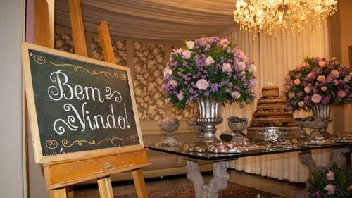 Welcoming stand near table with sweet cake