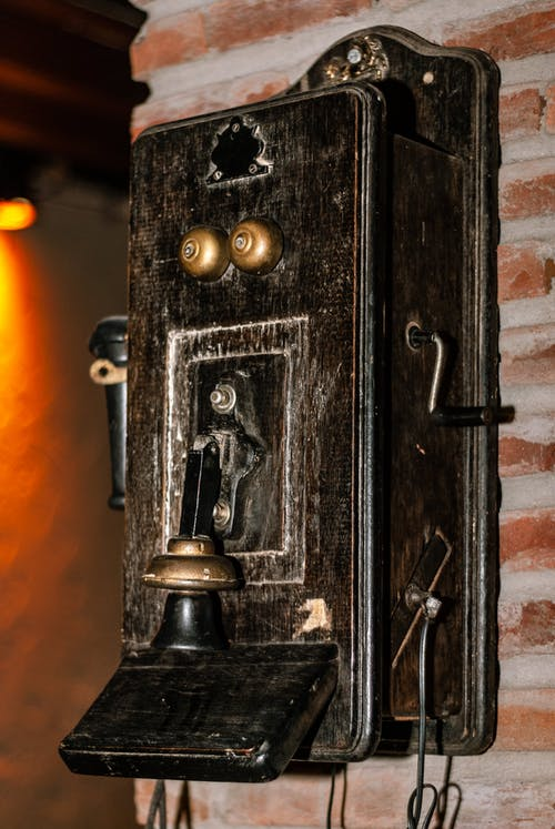 Shabby retro telephone hanging on wall