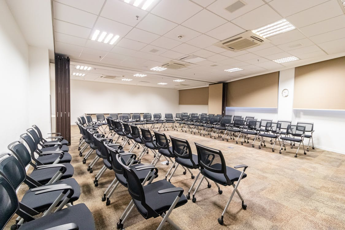 Empty seats in conference room in office center